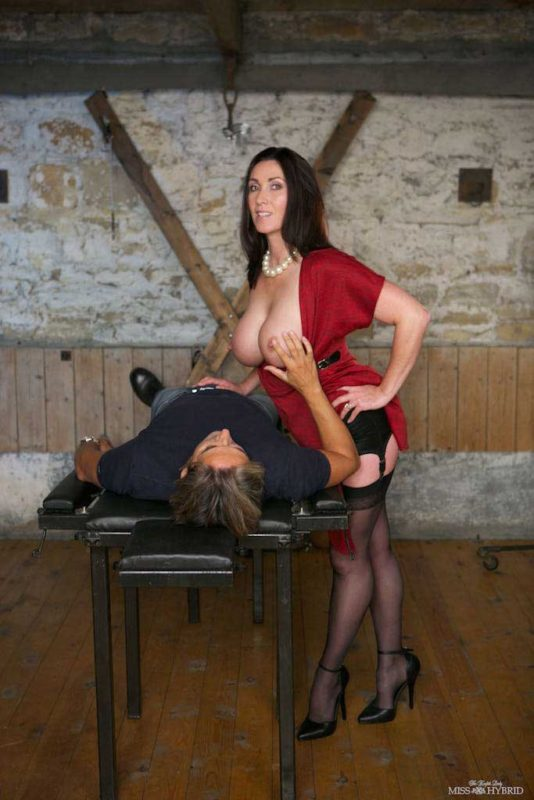 Miss Hybrid sexy stockings long legs and high heels tit out in the dungeon.